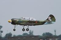 - acrobatic airplane Yakovlev Yak-52 during an air show on air force base of Ghedi (Brescia)....- aereo acrobatico Yakovlev Yak-52 durante un esibizione sulla base aerea di Ghedi (Brescia)......