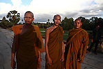 Young Buddhist monks pause for a photograph at Angkor Wat, Cambodia. June 8, 2013.
