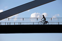 Netherlands, Province Limburg, Maastricht: Cyclist on a bridge crossing the River Maas