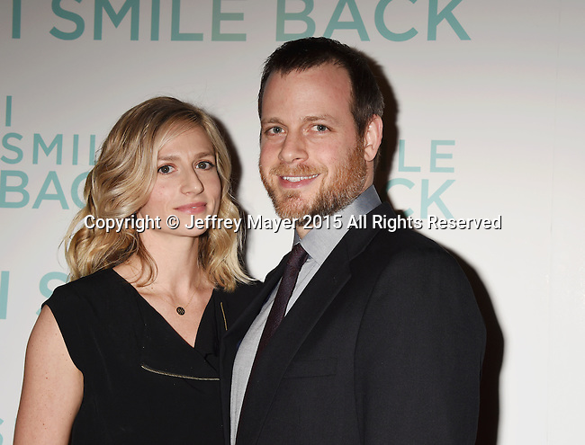 HOLLYWOOD, CA - OCTOBER 21: Director Adam Salky (R) and wife Dr. Sarah Sicher arrive at the premiere of Broad Green Pictures' 'I Smile Back' at ArcLight Cinemas on October 21, 2015 in Hollywood, California.