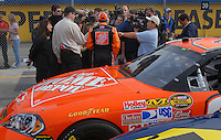 Feb 11, 2007; Daytona, FL, USA; Nascar Nextel Cup driver Tony Stewart (20) is interviewed by the media during qualifying for the Daytona 500 at Daytona International Speedway. Mandatory Credit: Mark J. Rebilas