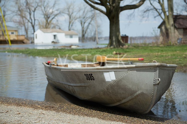 Rowboat floating on floodwaters