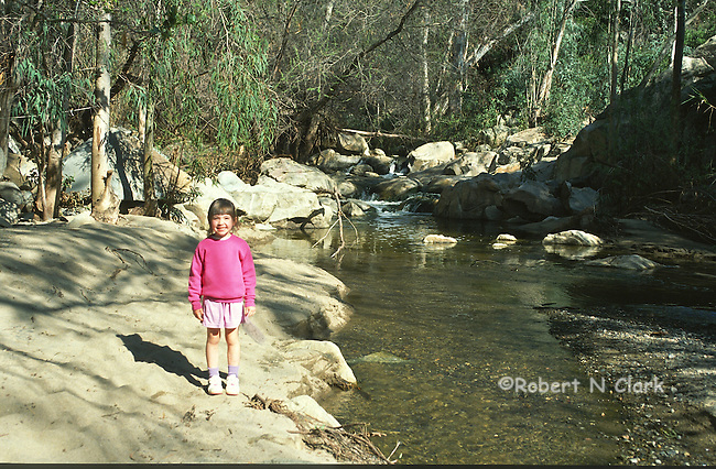 Girl by stream