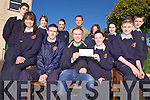 SUPPORT: Students of Scoil Phobail Sliabh Luachra lending their support to locals, John F O'Connor and Jerry O'Leary who are going to build homes in Haiti following the recent earthquake.