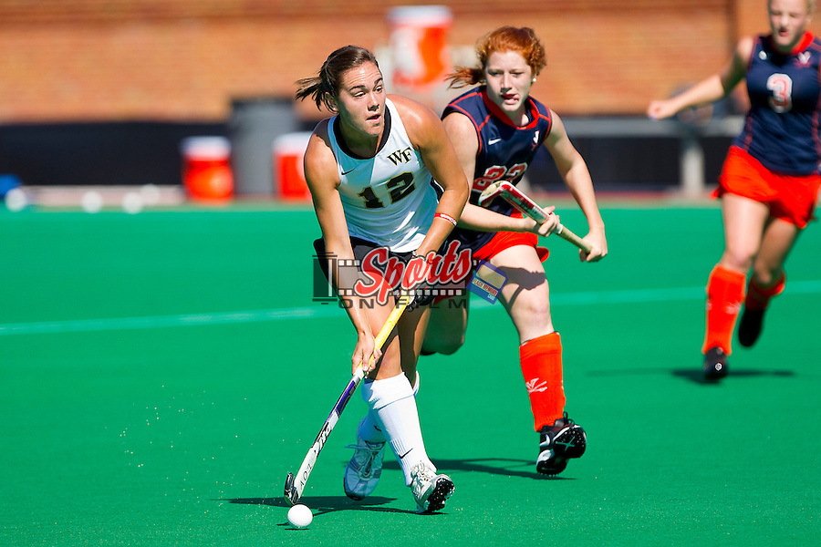 Cristen Atchison #12 of the Wake Forest Demon Deacons looks for an open teammate during first half action against the Virginia Cavaliers at Kentner Stadium October 22, 2011, in Winston-Salem, North Carolina.  The Demon Deacons defeated the Cavaliers 5-0..  Photo by Brian Westerholt / Sports On Film
