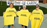 "Community Social Responsibility / CSR event photography of the United Way's annual Day of Caring event, which took place September 14, 2013 across the Mooresville and Lake Norman area.  ""Day of Caring is a great way for our community to show how much they care about our local neighbors in need,"" Linda Beck, United Way community director for Mooresville/Lake Norman, said in a statement.  ""Fundraising is vital but not immediately visible – this day allows us to put a face to United Way, both in terms of those who take the time to serve, and those who gratefully benefit from the acts of service.""<br /> Photo is part of a full event picture story by Charlotte Photographer - PatrickSchneiderPhoto.com"