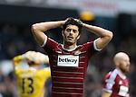 West Ham's James Tomkins looks on dejected after Tottenham score a late goal<br /> <br /> Barclays Premier League - Tottenham Hotspur  vs West Ham  - White Hart Lane - England - 22nd February 2015 - Picture David Klein/Sportimage