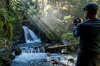 Man photographs Virgin Creek Falls in Girdwood, Alaska<br /> <br /> <br /> Photo by Jeff Schultz/SchultzPhoto.com  (C) 2018  ALL RIGHTS RESERVED