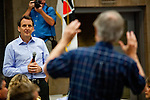 Former Minnesota Gov. Tim Pawlenty, a GOP presidential candidate, takes a question at a town hall meeting at the Iowa Farm Bureau in Des Moines, Iowa, July 20, 2011.