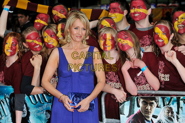 "JK ROWLING aka Joanne ""Jo"" Murray.Arriving at the World Premiere of ""Harry Potter and the Half-Blood Prince"" at the Odeon cinema, Leicester Square, London, England, UK, July 7th 2009..Half Blood length blue dress clutch bag  red nails gold bracelet earrings dangly cleavage quidditch fans .CAP/PL.©Phil Loftus/Capital Pictures"