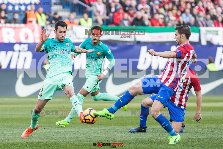 Sergio Busquets of Futbol Club Barcelona competes for the ball with Gabi Fernandez of Atletico de Madrid  during the match of Spanish La Liga between Atletico de Madrid and Futbol Club Barcelona at Vicente Calderon Stadium in Madrid, Spain. February 26, 2017. (ALTERPHOTOS) /NortEPhoto.com