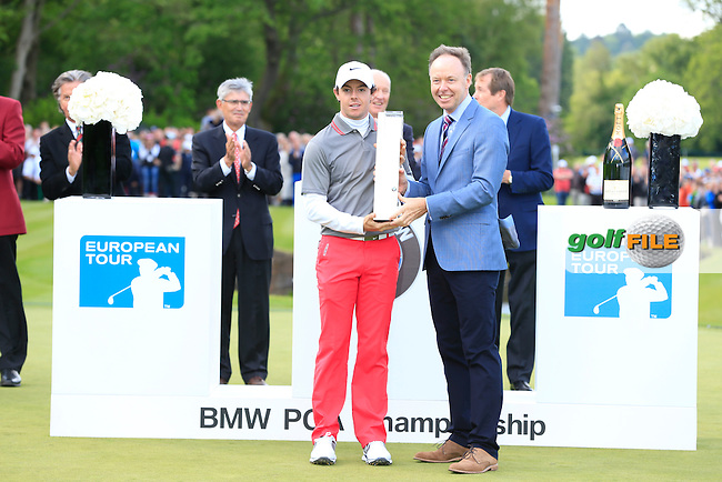 Dr Ian Robertson, Member of board of management BMW AGM with Rory MCILROY (NIR) who is the 2014 BMW PGA champion. The tournaments was played on the West Course, Wentworth Golf Club, Virginia Water, London.<br /> Picture: Fran Caffrey www.golffile.ie