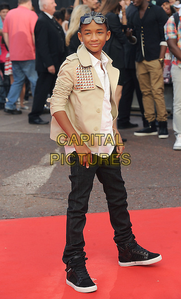 "JADEN SMITH.The Gala Premiere of ""The Karate Kid"", Odeon Leicester Square, London, England, UK..15th July 2010.full length cream beige jacket sunglasses black trousers trainers side studs studded white shirt.CAP/BEL.©Tom Belcher/Capital Pictures."