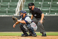 Rome Braves catcher Ryan Query #25 sets a target as home plate umpire Junior Valentine looks on during the South Atlantic League game against the Kannapolis Intimidators at CMC-Northeast Stadium on August 5, 2012 in Kannapolis, North Carolina.  The Intimidators defeated the Braves 9-1.  (Brian Westerholt/Four Seam Images)