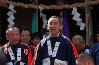 Festival officials sing and chant to officially end the Kanamara matsuri or festival of the iron phallus in Kawasaki Daishi near Tokyo, Japan. Sunday April 1st 2012