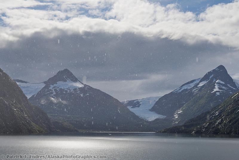 Rain falls over Portage lake and the Chugach mountains, Alaska.