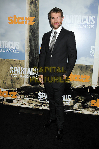 """Liam McIntyre.""""Spartacus: Vengeance"""" Premiere Screening held at Arclight Cinemas, Hollywood, California, USA..January 18th, 2012.full length hand in pocket black white stubble tie suit  beard facial hair.CAP/ADM/BP.©Byron Purvis/AdMedia/Capital Pictures."""