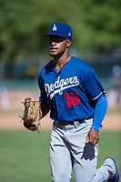 Los Angeles Dodgers outfielder Daniel Robinson (16) jogs off the field between innings of an Instructional League game against the San Diego Padres at Camelback Ranch on September 25, 2018 in Glendale, Arizona. (Zachary Lucy/Four Seam Images)