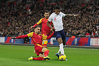 Marcus Rashford of England is tackled by Marko Vesovic of Montenegro during the UEFA Euro 2020 Qualifying Group A match between England and Montenegro at Wembley Stadium on November 14th 2019 in London, England. (Photo by Matt Bradshaw/phcimages.com)<br /> Foto PHC Images / Insidefoto <br /> ITALY ONLY