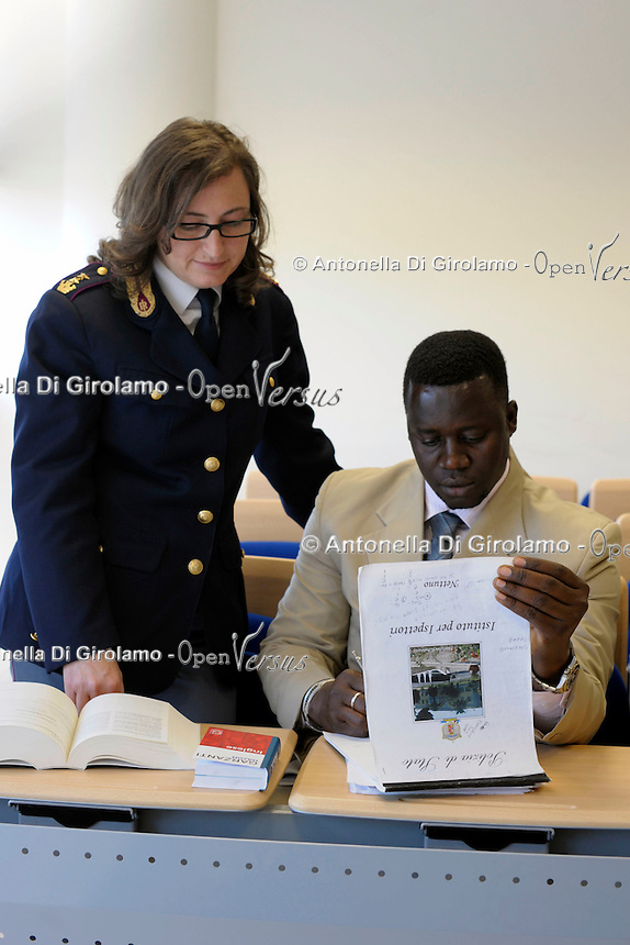 Ispettori di polizia del Gambia frequentano un corso di italiano per stranieri, tenuto dall'Upter, presso l'Istituto per Ispettori di Polizia di Nettuno..Police officers of the Gambia attend an Italian course with teachers of Upter, held at the Institute for police inspectors,in Nettuno..Upter. L' Università popolare di Roma si occupa dell' apprendimento permanente degli adulti.Popular University of Rome is responsible for Life Long Learning...
