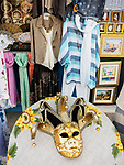 Clothing , paintings, carnivale mask, the colorful village of Burano, Italy.