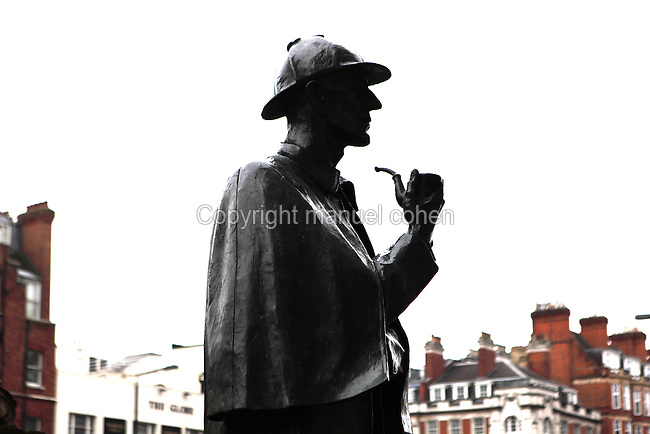 "Sherlock Holmes, ""The Great Detective"", bronze statue, 1999, John Doubleday, commissioned by Sherlock Holmes Society of London, Baker Street, silhouetted against an opaque morning light, London, UK. Picture by Manuel Cohen"