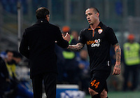 Calcio, ottavi di finale di Coppa Italia Tim: Roma vs Sampdoria. Roma, stadio Olimpico, 9 gennaio 2014.<br /> AS Roma midfielder Radja Nainggolan, of Belgium, greetes coach Rudi Garcia, of France, left, as he left, as he leaves the pitch during the Italy Cup round of sixteen football match between AS Roma and Sampdoria at Rome's Olympic stadium, 9 January 2014.<br /> UPDATE IMAGES PRESS/Isabella Bonotto