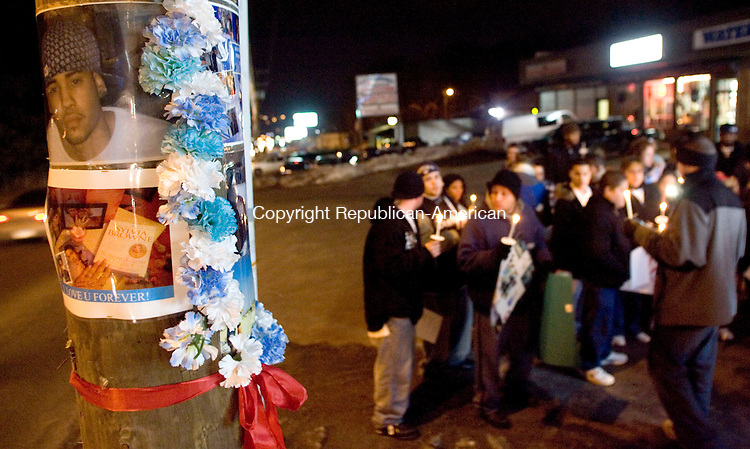 WATERBURY, CT- 22 JAN 2008- 012208JT05-<br /> Roughly 70 people gathered for a candlelight vigil in memory of Joel A. Gonzalez on Tuesday night near 540 Lakewood Rd. in Waterbury. Tuesday marked one year since Gonzalez, 19 at the time, died in a car accident not far from where the vigil was held. On Sunday, a service at St. George's Roman Cathoic Church in Bridgeport will be held in honor of Gonzalez.<br /> Josalee Thrift / Republican-American