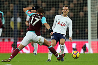 Christian Eriksen of Tottenham and Javier Hernandez of West Ham United during Tottenham Hotspur vs West Ham United, Premier League Football at Wembley Stadium on 4th January 2018