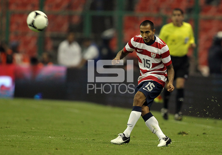 MEXICO CITY, MEXICO - AUGUST 15, 2012:  Edgar Castillo (15) of the USA MNT makes a pass against  Mexico during an international friendly match at Azteca Stadium, in Mexico City, Mexico on August 15. USA won 1-0.