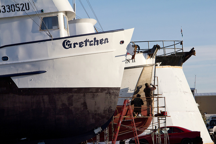 Port Townsend, men working on boats, Boat Haven Marina, Puget Sound, Washington State,