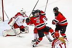 19 MAR 2016: The Division lll Women's Ice Hockey Championship is held at the Ronald B. Stafford Ice Arena in Plattsburgh, NY. Plattsburgh defeated Wis.-River Falls 5-1 for the national title. Wis.-River Falls' Dani Sibley gets caught in a fray in front of Plattsburgh's goal. Nancie Battaglia/NCAA Photos