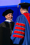 Craig W. Hartman, world-renowned architect, is congratulated by the Rev. Dennis H. Holtschneider, C.M., president of DePaul University after receiving his honorary degree Sunday, June 11, 2017, during the DePaul University College of Science and Health and College of Liberal Arts and Social Sciences commencement ceremony at the Allstate Arena in Rosemont, IL. The Rev. Dennis H. Holtschneider, C.M., president of DePaul University looks on. (DePaul University/Jamie Moncrief)
