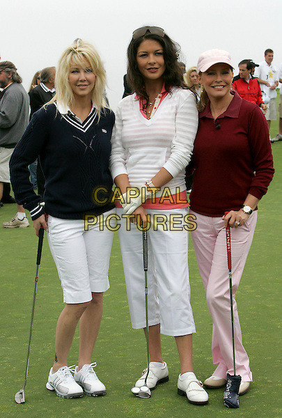 HEATHER LOCKLEAR, CATHERINE -ZETA JONES & CHERYL LADD .The 9th Annual Michael Douglas & Friends Celebrity Golf Tournament held at The Trump National Golf Club in Rancho Palos Verdes, California, USA..April 29th, 2007.sport full length blue sweater jumper club tee putter cropped white trousers pink striped stripes red.CAP/DVS.©Debbie VanStory/Capital Pictures