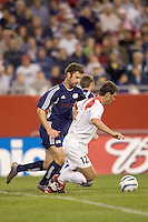 Pat Noonan works to dispossess Jeff Agoos. The NE Revolution defeated NY Metro Stars, 1-0, on September 24 at Gillette Stadium.