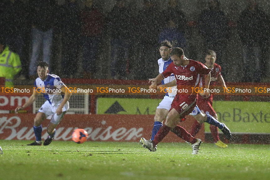 Andy Drury of Crawley Town passes in the rain - Crawley Town vs Bristol Rovers - FA Challenge Cup 2nd Round Replay Football at the Broadwood Stadium, Crawley, West Sussex - 18/12/13 - MANDATORY CREDIT: Simon Roe/TGSPHOTO - Self billing applies where appropriate - 0845 094 6026 - contact@tgsphoto.co.uk - NO UNPAID USE