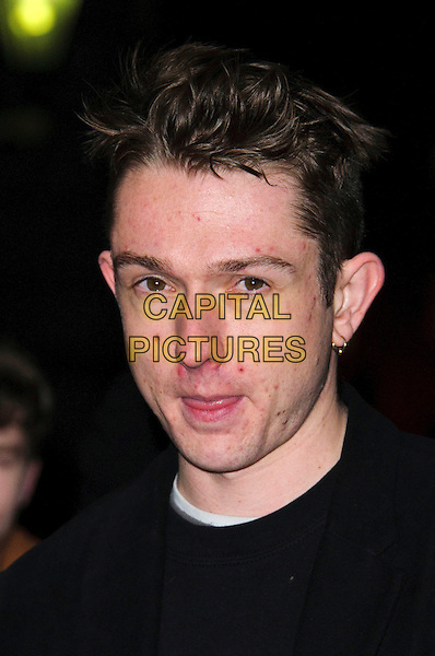 Thom Green of Alt-J.Brits 2013 Nominations Party - Outside Arrivals, London, United Kingdom,.10th January 2013..portrait headshot spots acne bad skin black  earring gold .CAP/CJ.©Chris Joseph/Capital Pictures.