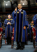 South Bend, IN - May 17, 2009 -- United States President Barack Obama gives a thumbs-up to the Notre Dame University graduating class of 2009 during the 164th commencement ceremonies on the campus of Notre Dame University in South Bend, Indiana May 17, 2009. Obama received an honorary law degree from the university during the commencement. .Credit: Jeff Haynes / Pool via CNP