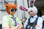 Cosplayers pose for a photograph during the Comic Market 90 (Comiket) event in Tokyo Big Sight on August 12, 2016, Tokyo, Japan. Many manga and anime fans wearing cosplay lined up in the sun for the first day of Comiket. Comiket was established in 1975 and focuses on manga, anime, gaming and cosplay. Organizers expect more than 500,000 visitors to attend this year's summer event which runs for three days until August 14. (Photo by Rodrigo Reyes Marin/AFLO)