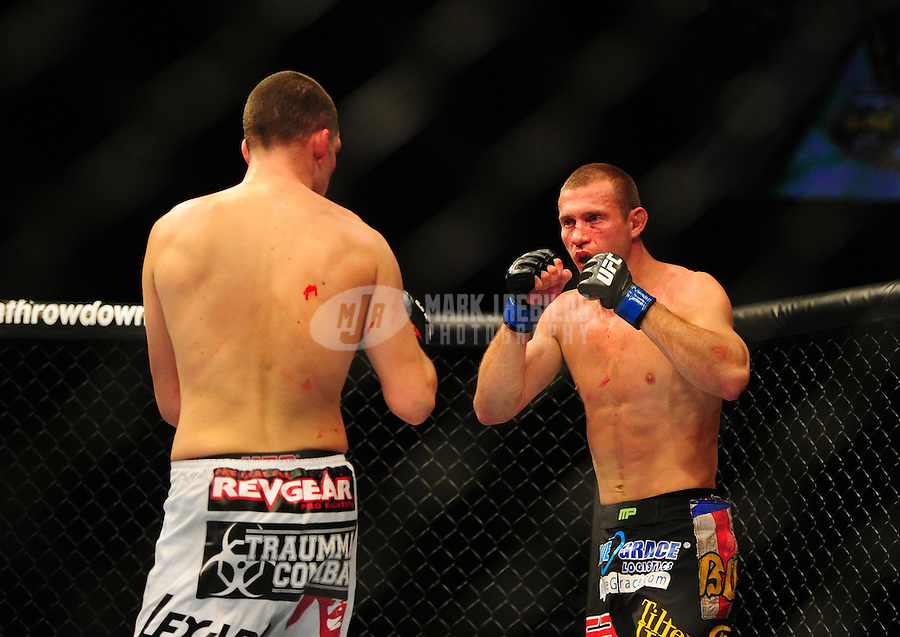 Dec 30, 2011; Las Vegas, NV, USA; UFC fighter Donald Cerrone (right) against Nate Diaz during a lightweight bout at UFC 141 at the MGM Grand Garden event center. Mandatory Credit: Mark J. Rebilas-