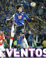 BOGOTA - COLOMBIA -14 -03-2015: Rafael Robayo (Der.) jugador de Millonarios disputa el balón con Yerry Mina (Izq.) jugador de Independiente Santa Fe, durante partido entre Millonarios e Independiente Santa Fe por la fecha 10 de la Liga Aguila I-2015, jugado en el estadio Nemesio Camacho El Campin de la ciudad de Bogota. / Rafael Robayo (R) player of Millonarios vies for the ball with Yerry Mina (L) player of Independiente Santa Fe, during a match between Millonarios and Independiente Santa Fe, for the  date 10 of the Liga Aguila I-2015 at the Nemesio Camacho El Campin Stadium in Bogota city, Photo: VizzorImage / Luis Ramirez / Staff.