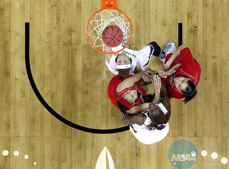 07 APR 2013:  University of California and University of Louisville players eye the ball as it sails through the hoop during the Division I Women's Basketball Championship in New Orleans, LA.  Louisville defeated California 64-57 to advance to the national title game.  Jamie Schwaberow/NCAA Photos