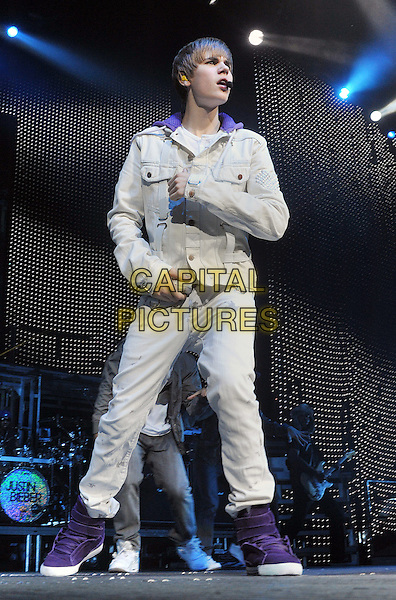 "JUSTIN BIEBER.Justin Bieber performs to a sold outcrowd at a stop on his """"My World Tour 2010"" held at the Consol Energy Center, Pittsburgh, PA, USA..December 13th, 2010.stage concert live gig performance music full length white jean denim jacket purple trainers sneakers hi high top singing .CAP/ADM/JN.©Jason L Nelson/AdMedia/Capital Pictures."