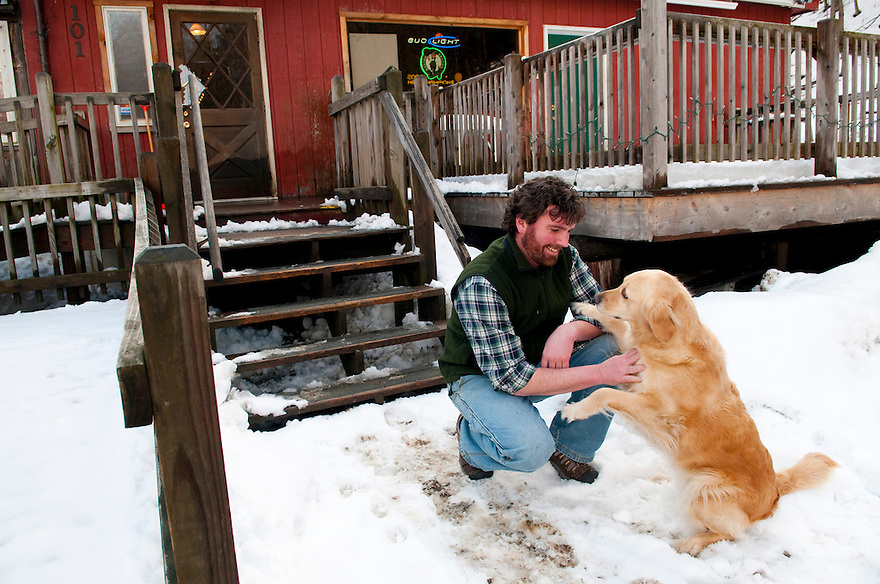 VERNON, VT -February 27, 2010--Outside Nesbitt's Portside Tavern owner Cameron Nesbitt with his dog, Barley. The tavern is just down the street from the Vermont Yankee Nuclear Power Plant, and news of its planned 2012 closure has hit the area hard.  CREDIT: JODI HILTON FOR THE NEW YORK TIMES