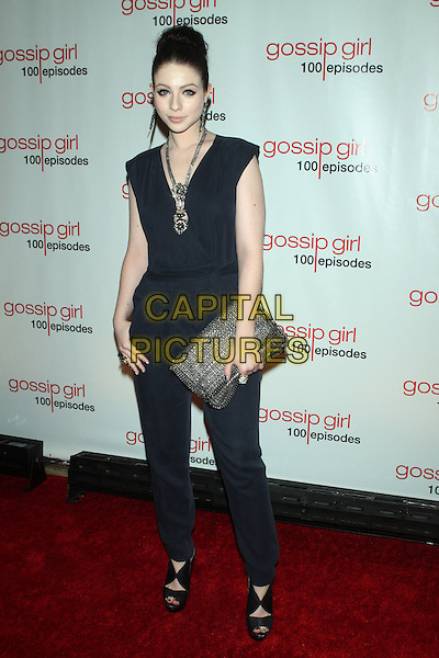 Michelle Trachtenberg.The 'Gossip Girl' 100th Episode Celebration at Cipriani Wall Street, New York, NY, USA..November 19th, 2011.full length blue black sleeveless jumpsuit clutch bag brown necklace .CAP/LNC/TOM.©LNC/Capital Pictures.