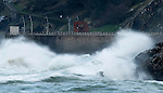 """A picture taken on February 15, 2016 shows waves hitting a retaining wall next to sculpture """"Empty Building"""" of the Basque sculptor Jorge Oteiza in the New Ride of Donostia, Basque Country. (Ander Gillenea / Bostok Photo)"""