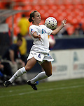 Kylie Bivens traps the ball at RFK Stadium in Washington, DC on 4/26/03 during a game between the Atlanta Beat and Washington Freedom
