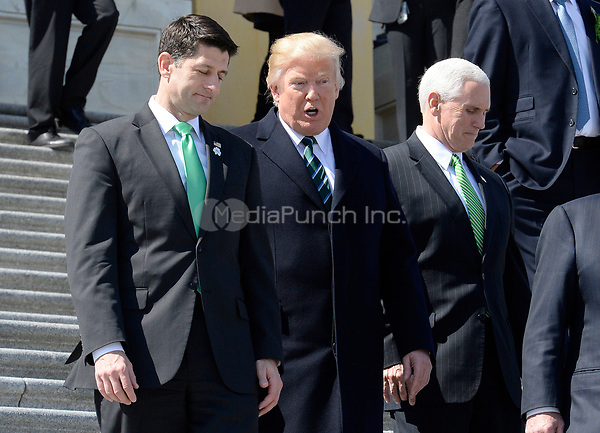 United States President Donald J. Trump, center, and US House Speaker Paul Ryan (Republican of Wisconsin), left, walk down the steps of the US Capitol after attending the Friends of Ireland Luncheon at the U.S Capitol on March 16, 2017 in Washington, DC.  US Vice President Mike Pence is at right.<br /> Credit: Olivier Douliery / Pool via CNP /MediaPunch