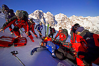 Fulpmes, Stubaital, Tirol, Austria, January 2006. Rescuers stabilize a training victim before transporting the injured down the ski slope.  The Bergrettung Tyrol mountain rescue teams have to respond to avalanches within 30 minutes if the victims are to have any chance of surviving. photo by Frits Meyst/Adventure4ever.com