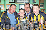 Killarney hurling fans l-r: Tom, Joe, Adam and Ivan Hurley who are Killkenny ex-pats get their hands on the Liam McCarthy cup in Jimmy O'Brien's bar Killarney on Monday night